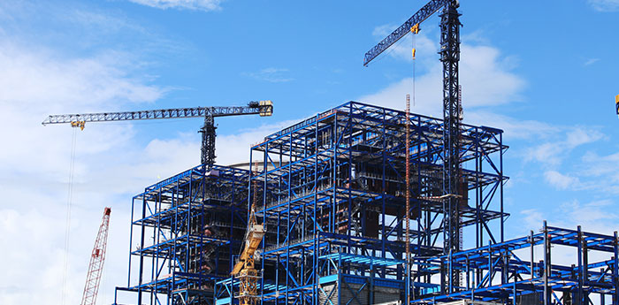 Construction Insurance: Cranes overlooking a building site.
