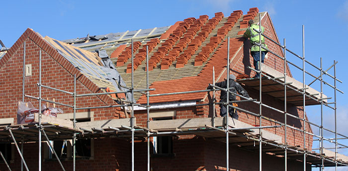 Latent Defects Insurance: The roof being retiled by two builders.